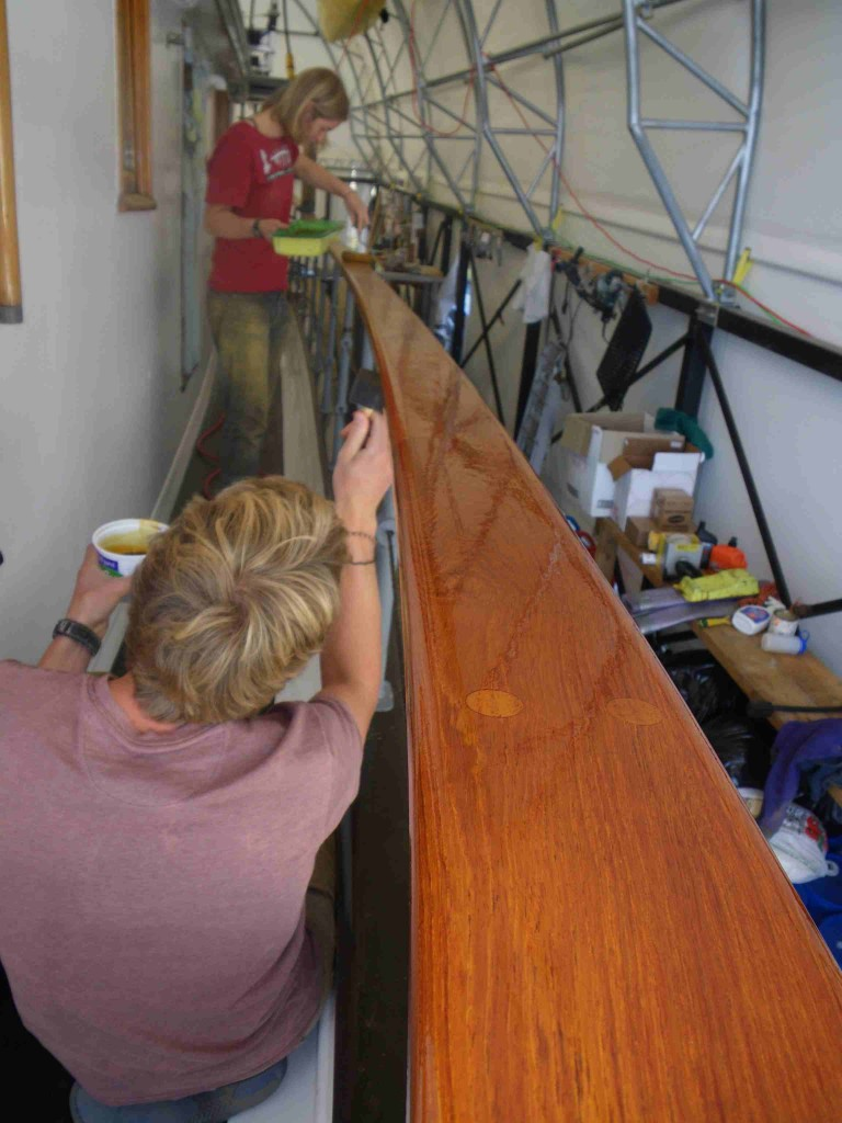 Teak handrails receive first coat of new finish